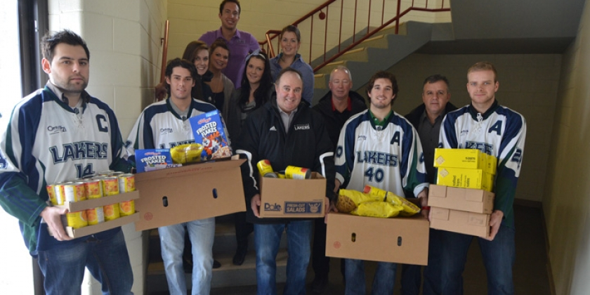 Group of Lakers Athletes show off their boxes of donations for the NUSU food bank