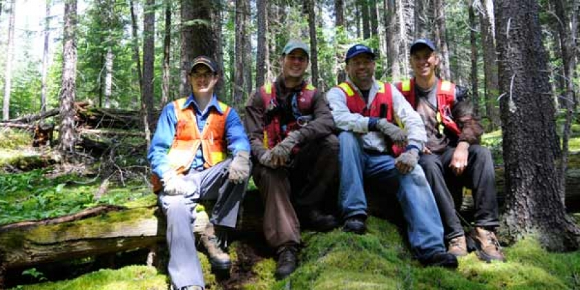 forest resource lab members taking a break from field work